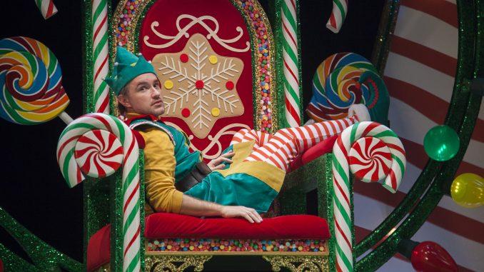 An elf sits on a throne.