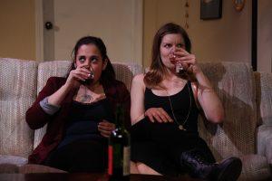 Two women drink wine
