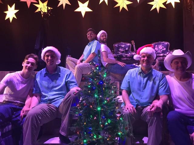Three couples around a Christmas tree